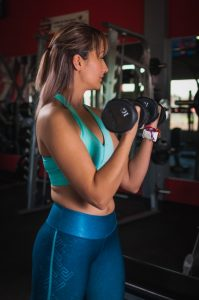 Woman holding dumbbells in the gym