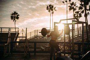 CrossFit workouts - man with a barbell outside
