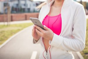 Best workout apps - woman with the phone