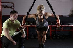 Woman exercising with trainer