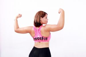 A girl flexing her arms.