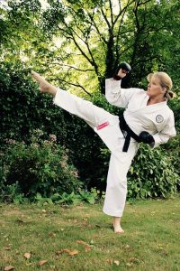 a woman practicing karate
