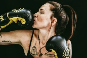 Girl kissing her boxing glove