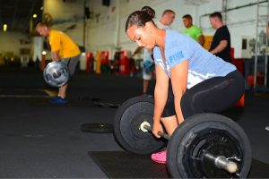 Weight lifting for women - woman preparing to lift weight bar