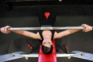 woman on press bench