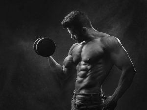 Bodybuilder with a dumbbell in black and white, planning his Ramadan weight loss