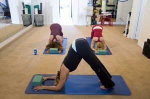 three girls doing yoga