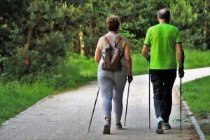 two seniors walking as part of exercises for seniors