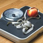A scale, measuring tape and a glass of water – helpful tools to maintain your weight loss.