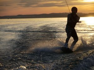 Wakeboarding at sunset is one of the best water sports in Dubai