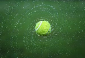 Tennis ball spinning in air after the shot
