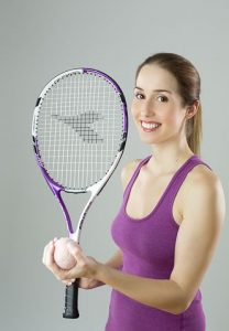 Girl with tennis equipment