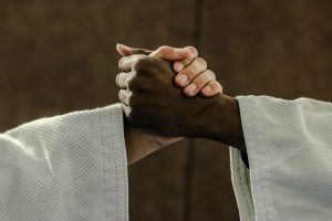 judo man shaking hands as one of the  Benefits of training judo