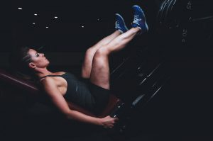 A woman doing a leg press.