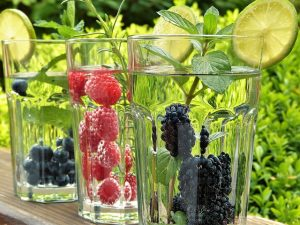 glasses of water with fruits that will help you get in shape fast