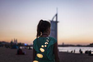 Girl standing on Dubai beach.