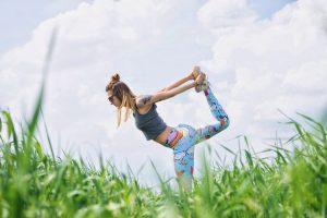 Woman doing yoga outside.