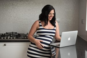 pregnant woman searching on losing weight after pregnancy