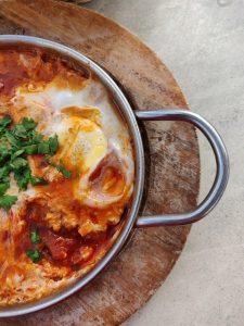 pot of tomatoe and eggs