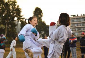 two children training karate