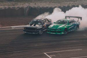 two cars in a drift race
