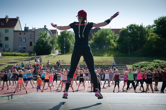Woman practicing Zumba, one of the hobbies that keep you fit