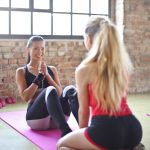 two women doing yoga together