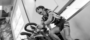 gym instructor giving spinning tips for beginners