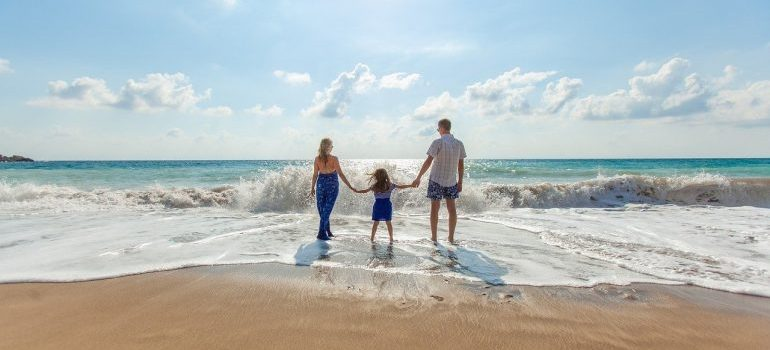 A family at the beach - one of the best family activities in Dubai.