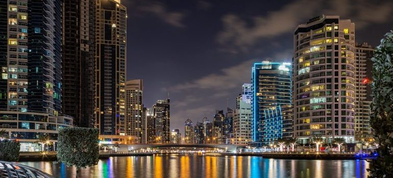 The Dubai Marina at night - one of the neighborhoods for expats in Dubai.