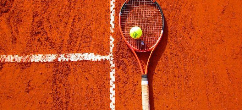A tennis racket on court.