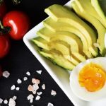 Eggs, chopped up avocado, and tomatoes.