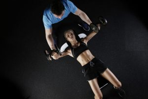 A woman working out with a trainer.
