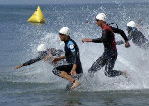 men running through water
