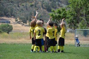 how to get your kids interested in sports - kids playing football