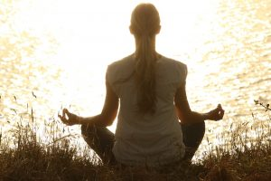 A woman meditating and forgetting about martial arts myths.