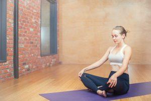 a woman in a home yoga studio