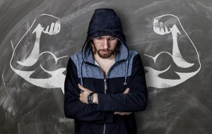 No equipment forearm workouts - a man in front of chack picture