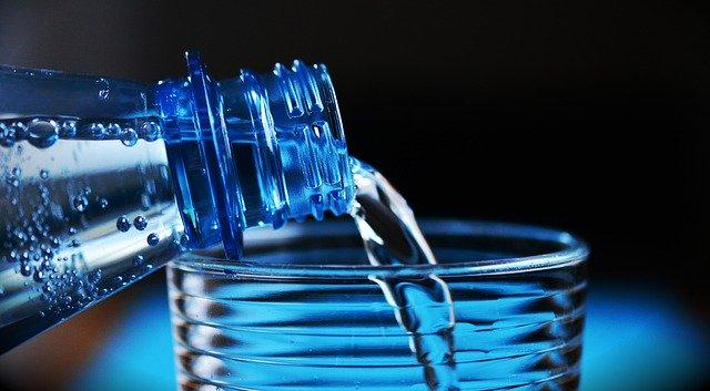 pouiring water in a glass