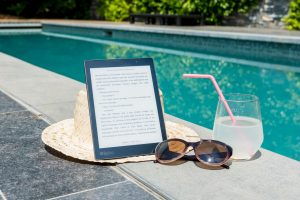 boomj and glasses next to a pool