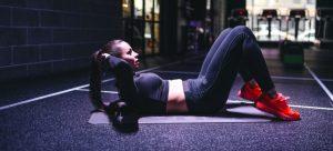 A woman doing sit-ups
