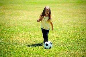 a girl playing football
