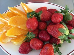 strawberries and oranges in plate