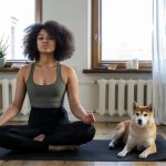 Woman doing yoga next to shiba inu