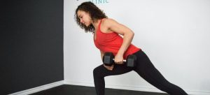 a girl lifting dumbbells