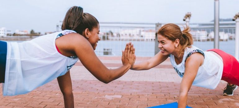 A girl doing an exercise with her instructor.