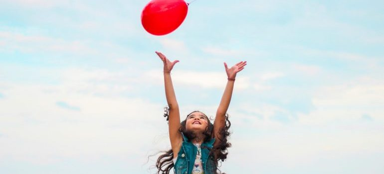a girl with a baloon