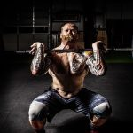 a man doing one of the best CrossFit workouts to make any man fitter