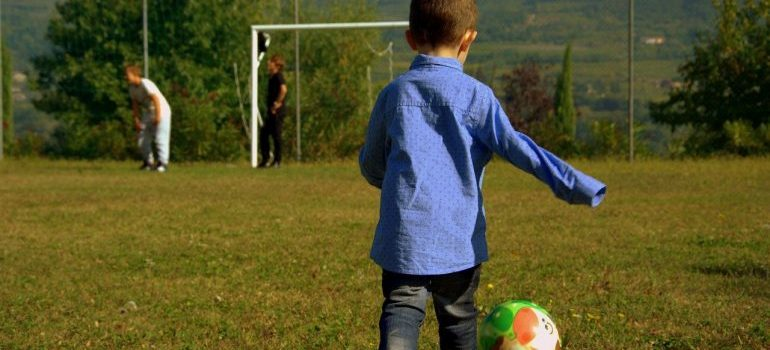 A child playing football.