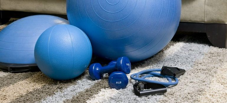 Blue fitness equipment to use carefully in order to prevent injury while exercising at home.